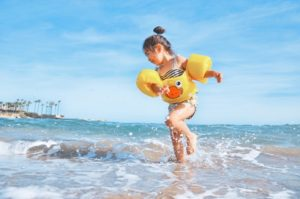 little girl running in the ocean