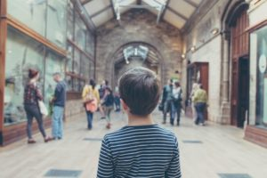 picture of a boy in a museum taken from behind his head