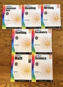 picture of spectrum workbooks laid out on floor