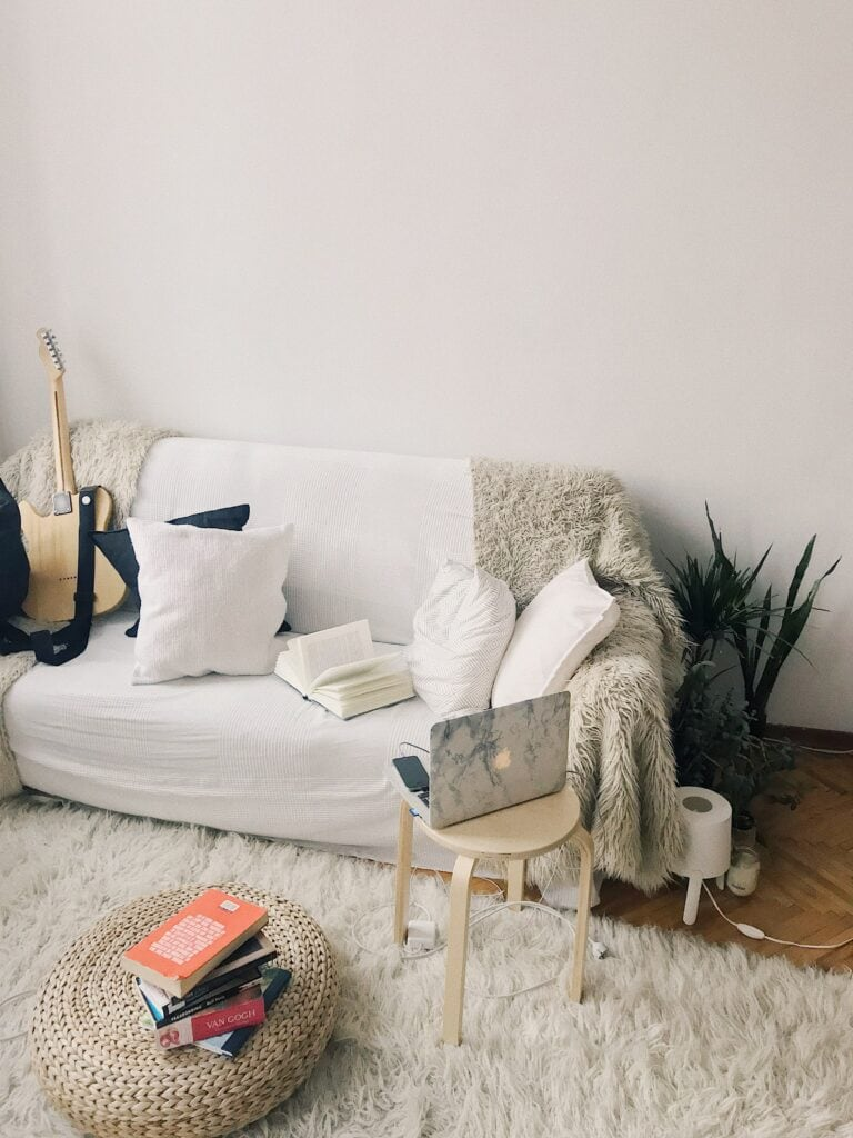 picture of a comfortable living room with white hues